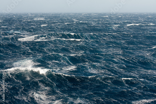 Foto op Aluminium Zee / Oceaan Stormy Winds Breaking Crests and Forming Streaks of Foam