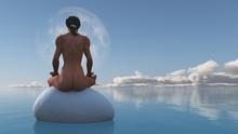 Woman Meditates Sitting On Sto...