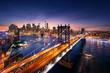 Leinwanddruck Bild New York City - beautiful sunset over manhattan with manhattan and brooklyn bridge