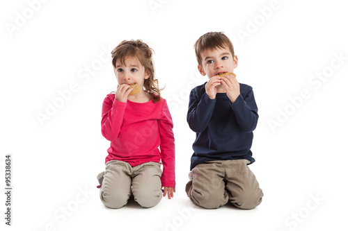 Valokuva  Twins eating cookies