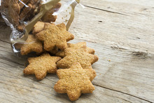 Christmas Cookies In Star Shape Falling From A Cellophane Bag On