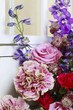 Floral arrangement with pink roses, carnations and delphinium fl
