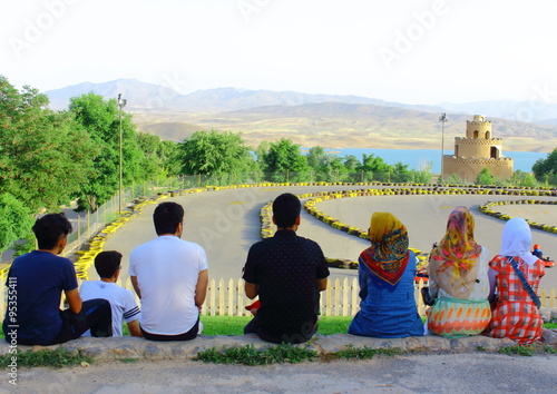 Poster Middle East Iranian family watching carting race next to the see!