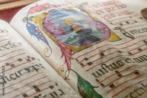 Fotografía  Medieval ancient illuminated manuscript with gregorian chant mus