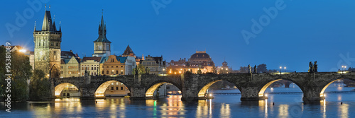 Poster Prague Evening panorama of the Charles Bridge in Prague, Czech Republic, with Old Town Bridge Tower, Old Town Water Tower and dome of the National Theatre