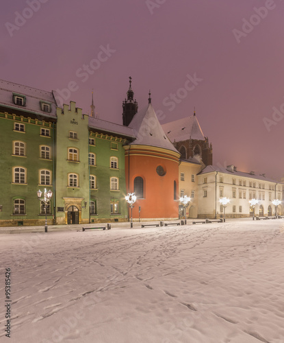 Small market square (Maly Rynek) in Krakow, Poland, on a winter night #95385426