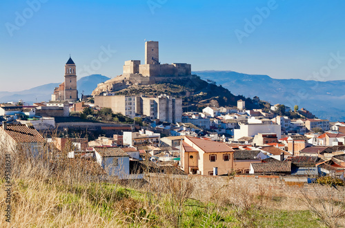 Obraz Alcaudete with castle and old church. Province of Jaen, Spain - fototapety do salonu