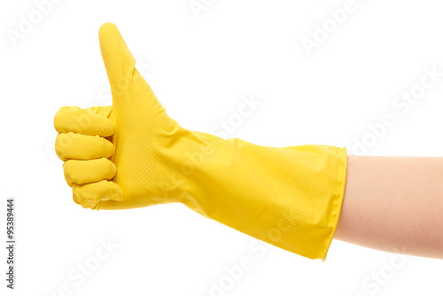 Fotografija  Close up of female hand in yellow protective rubber glove showing thumbs up sign