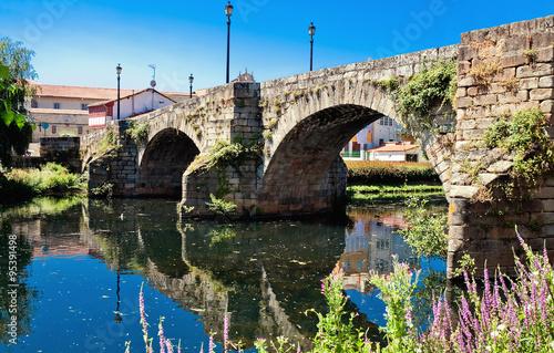 old Roman bridge in Monforte de Lemos, Galicia, Spain