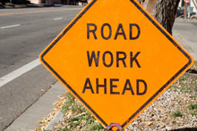 Road Work Ahead Sign On The Si...