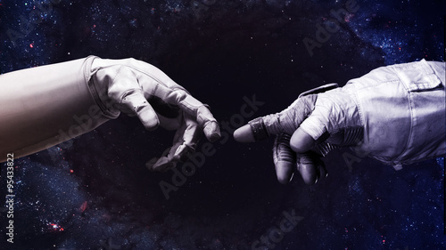 Ingelijste posters UFO Michelangelo God's touch. Close up of human hands touching with fingers in space. Elements of this image furnished by NASA