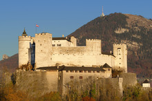 Salzburg Fortress Hohensalzburg In Austria. Castle In Front Of Gaisberg Mountain On The Right And The Nockstein On The Left. International Festival City For Classical Music And Birthplace Of Mozart.