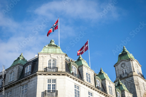 Photo  Norwegian and Danish flag on the rooftop