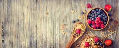 fototapeta na ścianę Fresh healthy breakfast with granola and berries, copy space rus