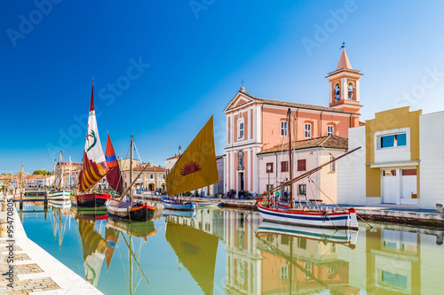 Stickers pour porte Pierre, Sable Church and ancient sailboats on Canal Port