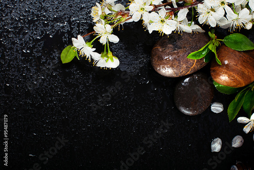 Foto auf Leinwand Spa Spa concept on a dark background. Sea salt, flowering branches of cherry, aromatic oils