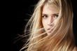 Leinwandbild Motiv Portrait of beautiful  blonde woman with flying hair.