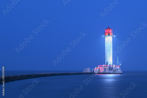 Fototapeten Leuchtturm view to lighthouse in blue twilight