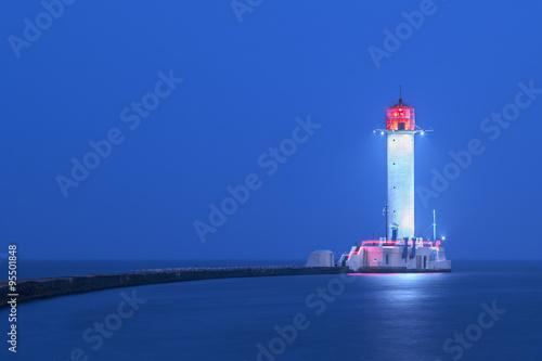 Foto auf Gartenposter Leuchtturm view to lighthouse in blue twilight