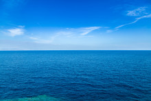 Blue Sea Waters And Clear Blue...