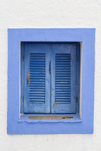 Window With Closed Blue Shutters