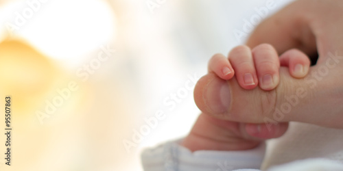 Newborn baby touching his mother hand Canvas Print