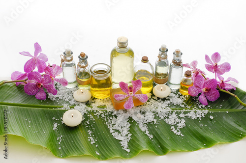 Fotobehang Spa health spa with bottle oil, candle, orchid and banana leaf