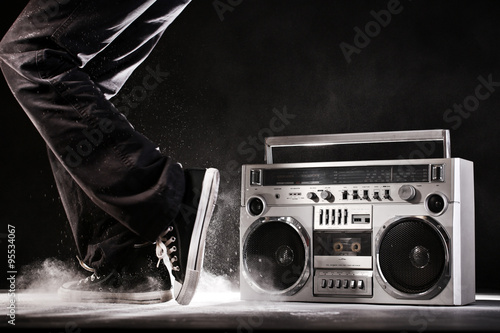 Foto  Retro ghetto boom box, dust and dancer isolated on black with cl