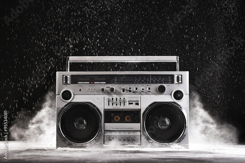Zdjęcie XXL 1980s Silver Retro ghetto blaster and dust isolated on black wit