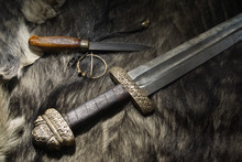 Viking Sword And Knife On A Fur