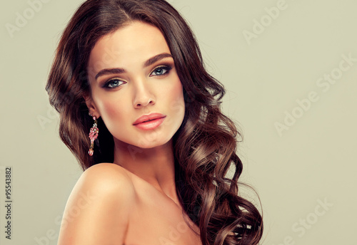 Beautiful girl light brown hair with an elegant hairstyle , hair wave ,curly hai Fototapeta