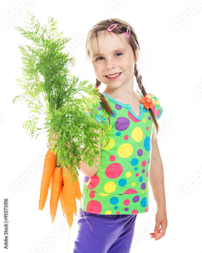 Foto op Canvas Schepselen A cute little girl with a bunch of fresh carrots on a white background.