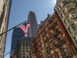 Waving American flag on the background of old buildings in New York