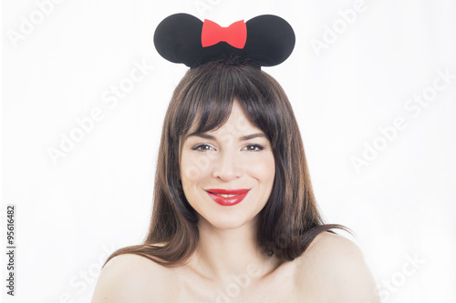 Photo  Beautiful girl smiling wearing mouse ears accessory