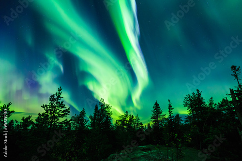 Photo sur Toile Aurore polaire Northern lights (Aurora borealis) in the sky