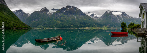 Foto op Canvas Bleke violet Boats and reflection in the water in panorama