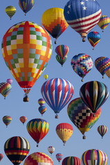 The mass ascension launch of over 100 colorful hot air balloons at the New Jersey Ballooning Festival in White-house Station, New Jersey as a early morning race.