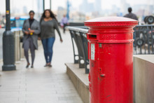 LONDON, UK - SEPTEMBER 14, 2015:  Royal Mail Red Post Box In Canary Wharf