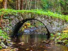 Small Old Stone Bridge In A Forest