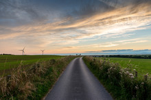 Road Through Countryside In Evening