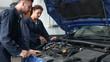 Mechanics repairing an engine