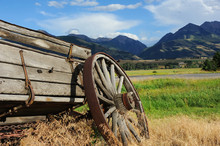 Broken Down Wagon Is Being Overtaken By Weeds.  Wagon Sits With A Beautiful View Of The Absaroka Mountains In Paradise Valley, Montana.