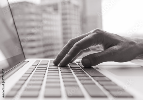 Fototapety, obrazy: Business person using a laptop computer.