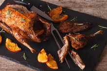 Sliced Roast Duck And Closeup On A Black Slate Board. Horizontal