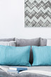Decorative turquoise and grey cushions