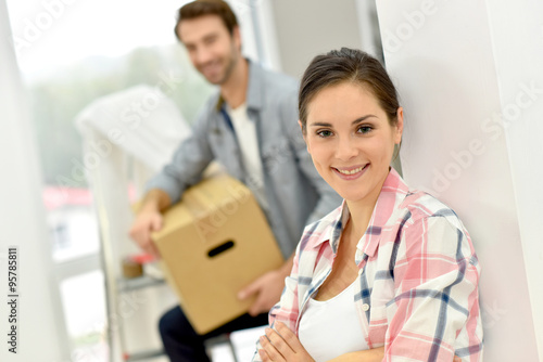 Fotografie, Obraz  Young couple moving into new home