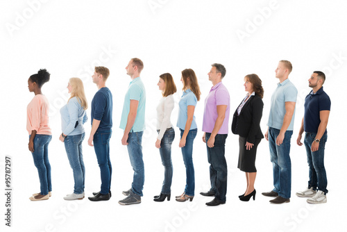 Fotografie, Obraz  Side View Of Creative Business People Standing In Row