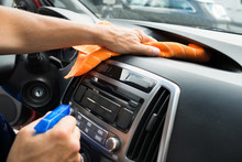 Male Worker Cleaning Car Dashboard