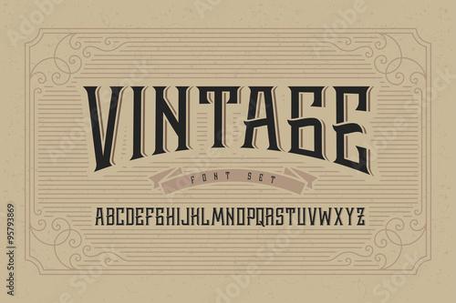 Fototapeta Vintage font set on cardboard texture vector background with decorative ornate frame. obraz