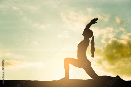 Yoga silhouette outdoor at sunset